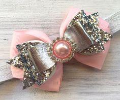 Super cute and sparkly over-the-top infant headband, baby headband, pink and silver first birthday Bow. Pink bow topped with super sparkly silver glitter and patent leather Bow. Can also be made as a clip. Rhinestone center.