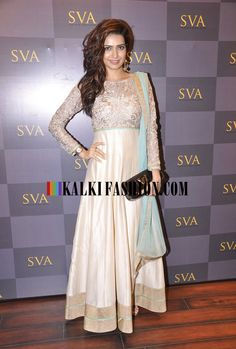 Karishma Tanna in an embroidered bodice anarkali suit by Sonam and Paras Modi at the launch of SVA Signature Studio.