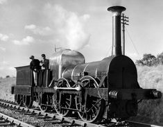 The 123-year-old Liverpool and Manchester Railway (LMR) 57 Lion steam locomotive, comes out of retirement from the museum at Crewe to drive up and down the Rugby-Leamington line at Dunchurch, with driver and fireman both wearing period costume, in October 1961