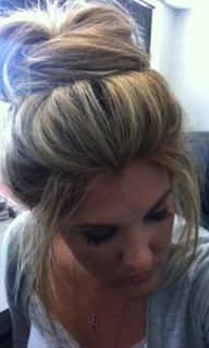 bobby pin bangs back in a poof...then pull back hair in high ponytail. on the third twist pulling through stop half way and leave a bun. Long pieces of hair that are left pull around the front and start pinning them down. pull out hair here and there for the cute messy look.