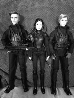 https://flic.kr/p/DM91yo | Hunger Games Mockingjay 2 Barbie dolls | Gale, Katniss and Peeta in military gear