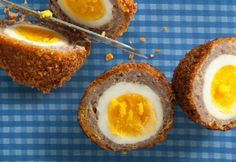Breakfast Sausage and Cornflake Scotch Eggs by Chow. A recipe for Scotch eggs that uses breakfast sausage and crushed cornflakes to coat the boiled eggs, which are then topped with a maple syrup drizzle. Homemade Scotch Eggs, Scotch Eggs Recipe, Think Food, I Love Food, Sausage Breakfast, Breakfast Recipes, Breakfast Ideas, Egg Recipes, Cooking Recipes