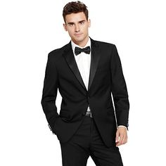 Tommy Hilfiger mens tuxedo jacket. Part of the manual to looking sharp—our timeless tuxedo jacket in four-season wool. Expertly tailored with high twist yarns that create a natural stretch for comfort. • Slim fit.• 100% wool. • Silk lapel, 2 covered buttons, double-vented back, lined.• Dry clean.• Imported.