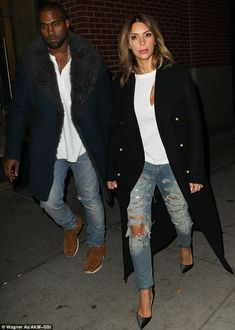 Letting rip: Kim's Kardashian and her better half Kanye West jeans were artfully torn with silver zips dotted over them
