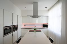 Amusing Kitchen Design Of Kamenschiki Apartment Ivan Selvinsky With Silver Colored Stainless Steel And Bright White Backsplash