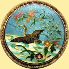 This Japanese button is high quality cloissonee enamel, probably made around 1900.The very fine gold wires are soldered on the face, and the coloured enamels held in place by the cloissons. The enamel is held in 925 silver and the rope border is 14 carat gold. The button is 3cms diameter.
