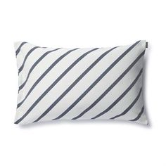 The Mint cushion cover was designed by Carina Seth Andersson in collaboration with the Finnish design brand Marimekko. The cushion cover is made of a strong cotton and polyester mix with a simple, striped pattern and button detailing. The pillow is a great nautical style pillow for the sofa or bed and is available in different colors.