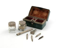 A late 18th century travelling ink set,  unmarked, circa 1760, the shagreen case of rectangular form, the hinged cover opens to reveal an unmarked silver mounted inkwell and sander, a pen and a desk seal, length 7.2cm.