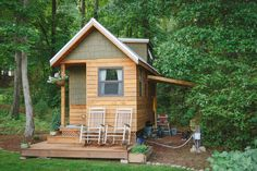 """A 204 sq ft tiny house by Wind River Custom Homes. A cozy wood cabin named the """"Wind River Bungalow""""."""