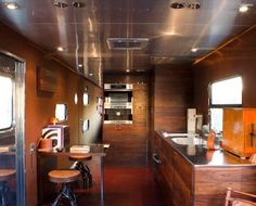 inside of 1955 trailer lined w/ reclaimed redwood complete w/ Miele kitchen   manifest manifest manifest