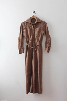 Fantastic faux suede (ultrasuede) jumpsuit from the 1970s. This jumpsuit features a workwear meets high fashion look with matching belt!