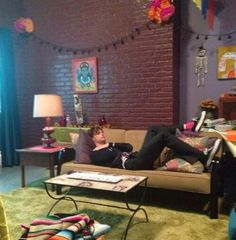 Matthew Gray Gubler full room and couch. Actually looks like people live there