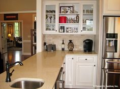 Open #kitchen cabinets allow you to display your favorite glassware and dishes! The Peyton #1289. http://www.dongardner.com/house-plan/1289/the-peyton. #HomeDesign #DreamHome