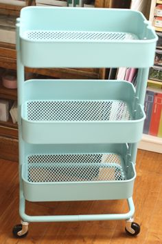 Ikea Cart, rolling carts from IKEA in turquoise and grey--I got the gray first and when I saw the seawater aqua I traded a friend .I keep supplies in it like, clean dishtowels and extra aqua Dawn, and potatoes and onions, so very useful and pretty. Ikea Kitchen Cart, Ikea Cart, Classroom Design, Classroom Decor, Ikea Raskog, Raskog Cart, Office Supply Organization, Organization Hacks, Classroom Organization