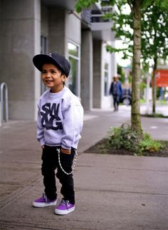 Purple shoes and Swag shirt. This kid is like a mini Bieber!