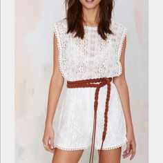 NASTY GAL ~ cream romper xs GORGEOUS !!!! Xs cream romper never worn !tags attached ! Top is see through so a bra or something will be needed unless you don't mind everyone seeing your nips ;) .. I can't wear cream or white because of a tattoo :( .. So have to sell :( Nasty Gal Pants Jumpsuits & Rompers