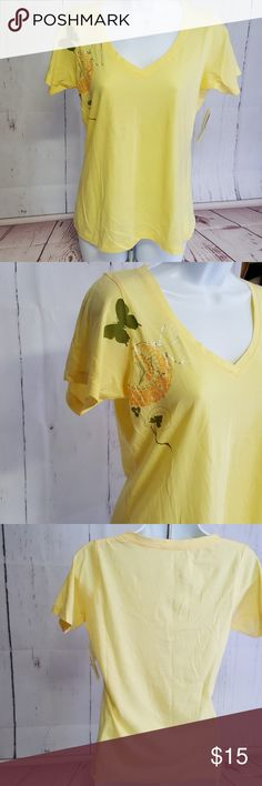 "NWT Under The Canopy Organic Cotton T-Shirt Beautifully soft yellow V-Neck T-Shirt with pretty butterfly. 34-36"" bust, 23"" long 100% organic cotton. NWT.  More like medium than LG. Under The Canopy Tops Tees - Short Sleeve"
