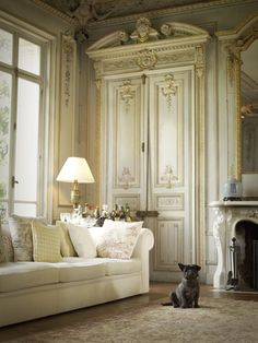 "A very glamorous French apartment. The lovely white Chesterfield sofa works nicely against the stunning architecture. From the book ""The French Dog"""
