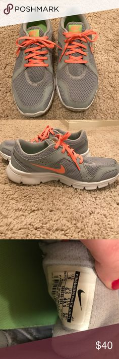 Nikes Gently worn, still in really good condition. Size 9. They are grey and the laces are a pretty coral color. Nike Shoes Athletic Shoes