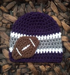 Crochet baby football beanie, boy, girl, adult, Baltimore, ravens, tcu, Minnesota, Vikings, purples gray, white on Etsy, $15.00  NFL, giants, cowboys, raiders, texans, packers, 49ers, rams, buccaneers, dolphins, redskins, jets, falcons, jaguars, panthers, titans, bills, bears, browns, steelers, bengals. Chiefs, broncos, colts, saints, eagles, chargers, cardinals, lions,