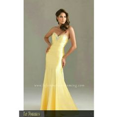 BEAUTIFUL LA FEMME PROM  LEMON DRESS LA FEMME  PALE LEMON PROM DRESS * SHELL.                    100% POLYESTER * LINING.                   100% POLYESTER * COLOR.                   PALE YELLOW * HEMLINE.              LONG / FLOOR * SILHOUETTE.      A-LINE / EMPIRE * SIZE                        6 This strapless flowing long gown will turn heads with its ruched Waistband & jeweled Neckline. Pre-loved and in excellent condition. 💜FEEL FREE TO MAKE A FAIR OFFER💜 La Femme Dresses Prom