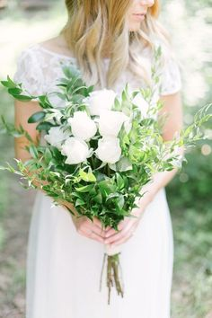 You'll Want to DIY Your Wedding Flowers After Seeing These Bouquets | Classic is the name of the game when it comes to this white rose and greenery bouquet. If traditional is more your style, order white roses and greenery for an easy DIY bouquet!