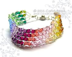 Swarovski bracelet Simply Sweet Rainbow Swarovski by candybead, $20.00 •Materials: swarovski crystal, 4mm, beads, silver seed beeds, clasp, silver chain, jumprings, bead tips, flower crystal, silver magnetic clasp