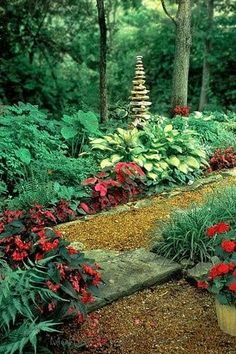 shade plants with stacked rocks for height and architectural interest