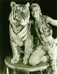 I was secretly in love with Gunther Gebel Williams from Ringling Brothers Circus..:)