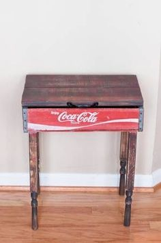 This accent table / end table / side table was made out of an old antique Coca Cola crate. The table has removable legs and a hinge top with handle was added to the top. The legs and table top were. Crate Furniture, Repurposed Furniture, Painted Furniture, Home Furniture, Furniture Ideas, Redoing Furniture, Old Coke Crates, Coke Crate Ideas, Coca Cola Vintage