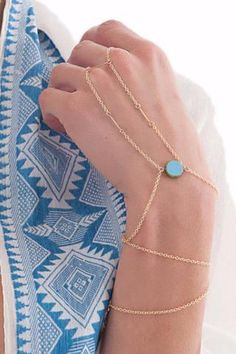 I love the look of hand chains like this! The cold is so pretty! I'm also a big fan of the turquoise stone on there. I would wear something like this all the time!