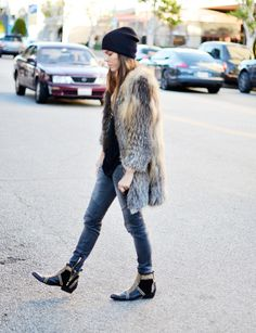 Fur + skinnies + beanie + studded ankle boots.