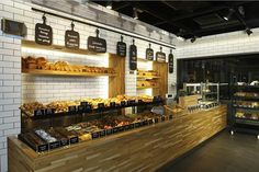 Komsufirin bakery by Autoban - I like the white subway tiles - hygenic-looking, white & black, and has the look of an old subway platform.