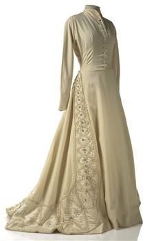 Circa 1950 Wedding dress of wool gaberdine with cord work embroidery executed on raw silk panels.  This medieval-style gown was designed by Italian high fashion house Carosa.  Via Museum of New Zealand Te Papa Tongarewa.