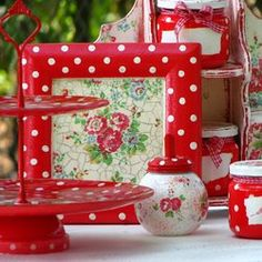 White polka dots w/ red. Love the dainty little floral jar.