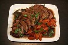 Braised Beef Chuck Roast Recipe: Beef Stock And Port Wine With Herbs, Bacon, Onions, Carrots, And Garlic