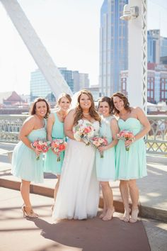 Love these colors! Perfect for a spring or summer wedding... #teal + #pink flowers. From Nikki and Andrew's gorgeous #nashville #wedding at #cellarone. Portrait on the #pedestrianbridge! Photo by Krista Lee