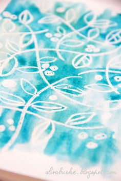 Draw on white paper with white crayon, then water color over it from Alisa Burke Blog