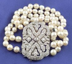 Art Deco Platinum, Natural Pearl, and Diamond Five-Strand Bracelet, composed of eighty-nine off white pearls with rose overtones, measuring approx. 7.20 to 5.85 mm, completed by an Art Deco clasp, bead and bezel-set with old mine, old European, and rose-cut diamonds, approx. total wt. 6.84 cts., lg. 6 1/4 in., with twenty-three loose pearls, 112 total.