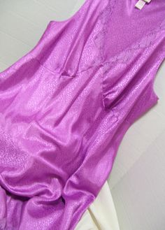 By Serenada, sexy for the curvy girl. Embossed, Lilac Pink Satin, Sexy Night Gown, Waltz, Plus Size 2X, Bridal Honeymoon, Resort Cruise, Full cut and comfortable  Marked a Size US Size Plus 2X  Pristine – never worn – no flaws or issues to state  Details  Bust: approx 52  Length underarm seam to hem: 34 (this measurement is the most accurate of where the item will hit on body)  Total Length approx 44  Label Serenda Fabric 100% embossed polyester satin Care Washable  All Items are carefully…