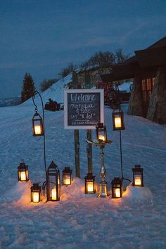 Lantern & ski welcome signage for mountain winter wedding. Decor & Planning by Harvest Moon Events | Photography by Bacio | Location Lookout Cabin Park City Mountain | www.harvestmoonevents.com