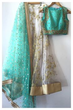 Flamboyant off white net lehenga choli, with resham work, embroidery work, lace work.This set is features a pale turquoise blouse in silk embroidery and sequin work.It has matching off white lehenga in net with beautiful embroidery all over and pale turqu Pakistani Dresses, Indian Sarees, Indian Dresses, Mode Bollywood, Bollywood Stars, Indian Wedding Outfits, Indian Outfits, Indian Attire, Indian Wear