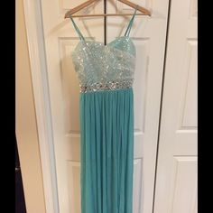 Prom Dress By Xtraordinary Prom dress size 11 floor length with jewells around waist, splint in front high-low, spaghetti straps NWT teal color Xtraordinary Dresses