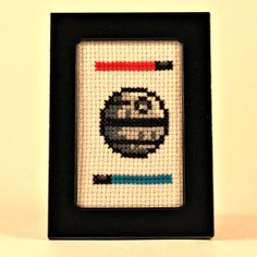 Hand stitched and framed Death Star... which side are you on? The cross stitch may be removed from the frame and be displayed with the cloth in