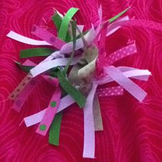 Ponytail holder wrapped in ribbon. 2013 Phoenix Synchornized Skating Preliminary Team colors