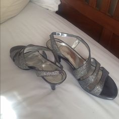 Silver heels Sparkly low heel dress shoe. Never worn. Just sitting in my closet. Perfect for any special occasion. Monet Shoes Heels