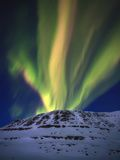 Aurora Borealis over Toviktinden Mountain in Troms County, Norway Fotografisk trykk av Stocktrek Images,