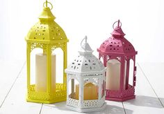 Add a pop of color to your screened porch or garden with these lovely painted lantern trio DIY from Martha Stewart's July 2015 Mad About Color Series.