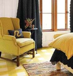 Take inspiration for a painted floor from fabrics in the same room. In this bedroom, a wing chair covered in a favorite yellow-and-plaid fabric echoes the floor's gingham motif. While a repetition of pattern may sound a bit staid, it actually establishes a simple and cohesive look.