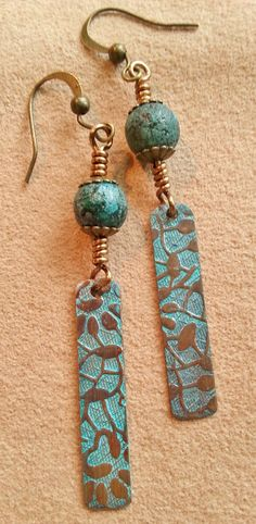 """Handmade stamped floral copper drops and 8mm stone picasso Czech glass beads on antique brass color wire. 2½"""" drop. $24"""
